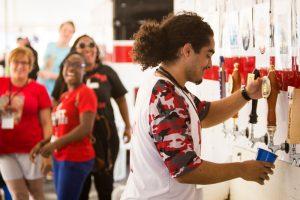 volunteer pumping beer.